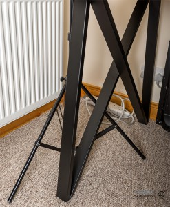 Close up of table leg and how lighting stands will fit underneath.